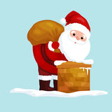 Christmas Santa Claus in red suit with bag full of gifts in the chimney Royalty Free Stock Images