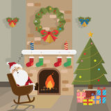Christmas santa claus relax fireplace room  Royalty Free Stock Photo
