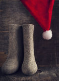 Christmas Santa Claus's hat and felt boots Stock Images