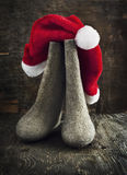 Christmas Santa Claus's hat and felt boots Stock Photo