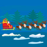 Christmas Santa Claus on sledge with reindeer and gifts Stock Photo