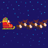 Christmas Santa Claus on sledge with reindeers and gifts Stock Photography