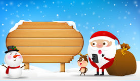 Christmas santa claus snowman and reindeer cartoon smile in fron Stock Image