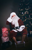 Christmas: Santa Claus Soaks His Feet After Exhausting Night Royalty Free Stock Image