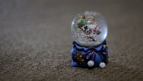 Christmas santa claus toy, ball with snow stock video footage