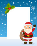 Christmas Santa Claus Vertical Frame. Christmas vertical photo frame with a cute cartoon Santa Claus with the sack of gifts, smiling and greeting on the snow Royalty Free Stock Photography