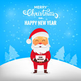 Christmas Santa Claus. Santa Claus in winter snow scene with blank sign Stock Photography