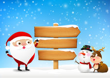 Christmas santa claus and wooden sign blank board and winter snow Stock Photography