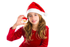 Christmas Santa cookie and Xmas dress kid girl. Isolated on white background royalty free stock photo