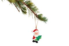 Christmas santa decoration on a spruce tree branch Royalty Free Stock Photo