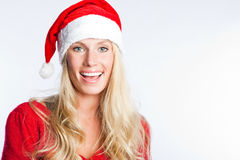 Christmas santa girl. A portrait of a beautiful caucasian christmas santa girl Stock Photos