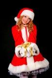 Christmas santa girl on black Stock Photos