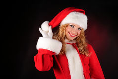 Christmas santa girl on black Stock Photos