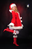 Christmas santa girl on black Stock Photography