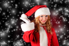Christmas santa girl on black Royalty Free Stock Photo