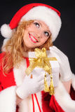 Christmas santa girl on black Stock Photo