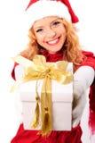 Christmas santa girl with gift Stock Image