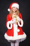 Christmas santa girl with gift Stock Photo