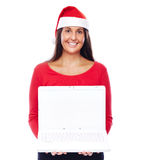 Christmas Santa girl Laptop. Woman In Christmas outfit Showing White Laptop Royalty Free Stock Photos