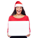 Christmas Santa girl Laptop. Woman In Christmas outfit Showing White Laptop Royalty Free Stock Image