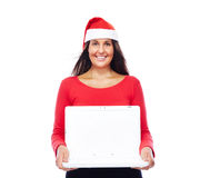 Christmas Santa girl Laptop. Woman In Christmas outfit Showing White Laptop Stock Photos