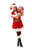 Christmas: Santa Girl Listening to Gift Stock Photography