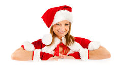 Christmas: Santa Girl Looking Over White Card Royalty Free Stock Photography