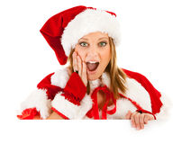 Christmas: Santa Girl Looking Over White Card Royalty Free Stock Photo