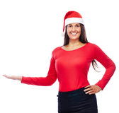Christmas Santa girl Showing. Woman In Christmas outfit Showing empty Copyspace Royalty Free Stock Photography