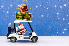 Christmas. Santa and Christmas, Golf car for celebration Stock Images