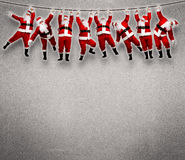 Christmas Santa hanging on rope. stock photos