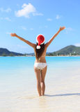 Christmas Santa hat bikini woman on beach holidays Royalty Free Stock Images