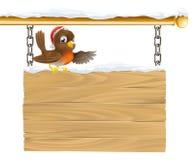 Christmas Santa hat bird on sign Stock Photos