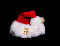 Christmas Santa Hat on black Stock Image