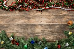 Christmas Santa hat flat lay backgrounds. With assorted xmas items red and green colors on rustic wooden table Royalty Free Stock Photos