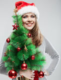 Christmas Santa hat isolated woman portrait. Royalty Free Stock Photo