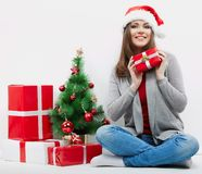 Christmas Santa hat isolated woman portrait hold christmas gift. royalty free stock photos