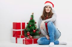Christmas Santa hat isolated woman portrait hold christmas gift. Royalty Free Stock Photography