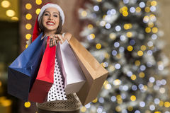 Christmas Santa hat isolated woman portrait hold christmas gift. Stock Images