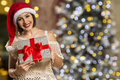 Christmas Santa hat isolated woman portrait hold christmas gift. Royalty Free Stock Image