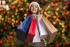 Christmas Santa hat isolated woman portrait hold christmas gift. Stock Image