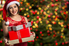 Christmas Santa hat isolated woman portrait hold christmas gift. Stock Photography