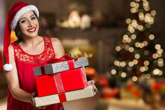Christmas Santa hat isolated woman portrait hold christmas gift. Stock Photo