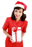 Christmas Santa hat isolated woman portrait hold christmas gift Royalty Free Stock Photo