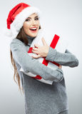 Christmas Santa hat isolated woman portrait hold christmas gift. Royalty Free Stock Photo