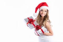 Christmas Santa hat isolated woman portrait hold christmas gift. Stock Photo