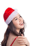 Christmas Santa hat isolated woman portrait hold christmas gift. Smiling happy girl on white background. Royalty Free Stock Photography