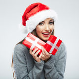 Christmas Santa hat isolated woman portrait hold christmas gift. Stock Photos