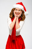 Christmas Santa hat isolated woman portrait . Smiling happy girl. On grey background. Girl in white and red clothes Stock Photography