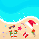 Christmas Santa Hat on Ocean Beach Flip-flops Sand Stock Image